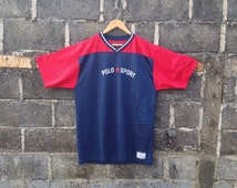 Vintage Polo Sport by Ralph Lauren, spelled out with a star, V-neck nylon jersey, red white & blue color, L size, made in USA
