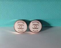 Chanel button earrings in white enamel