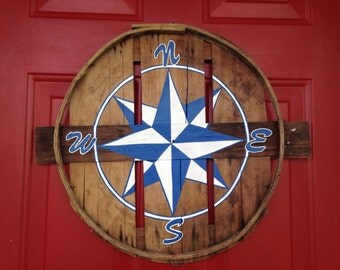 Nautical compass hand painted on recycled crab bushel lid.