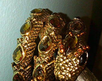 gold crystal serpent snake viper satanic occult ritual black magick stretchy bangle bracelet