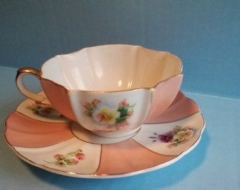MK hand painted scalloped  tea cup and saucer pink and white