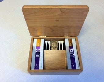 Golf box with tees, balls and divot tool