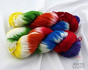 Rainbow Ice, hand dyed 100% superwash merino wool sock yarn. 410 yards