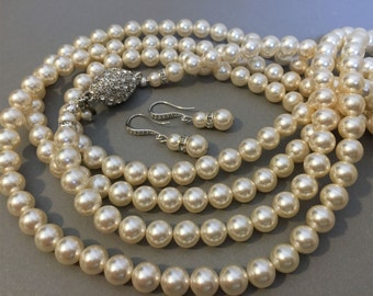 Long Flapper Pearl Necklace Set is made with one single 72 inch long strand of 8mm Swarovski pearls in Cream Ivory or your choice of color