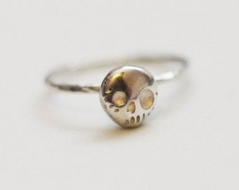 Delicate sterling silver skull ring