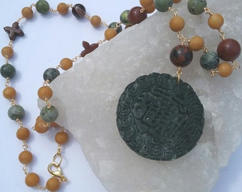 Carved Jade Disc with mixed gemstones