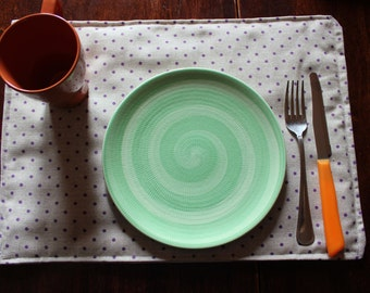 Pair of placemats from breakfast. Polka dot fantasy