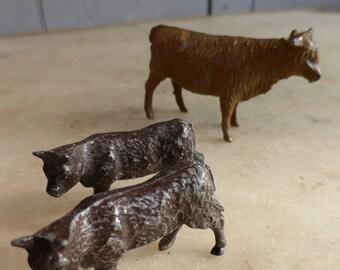 Three antique lead cows