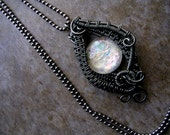 Black Gunmetal Gray Wire Wrapped Pendant - Dreamdrop - Super Color Shifting White Green Pink Moon - GLOW in the dark - Fairy Fey Vampire