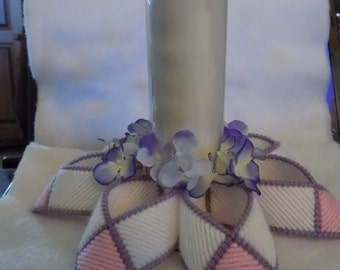 pink,white,and purple candle holder.