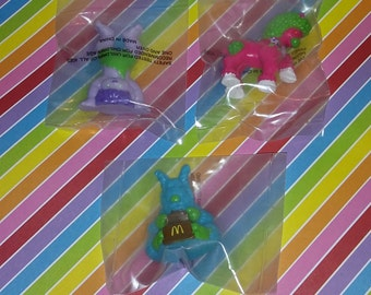 Vintage lot of 3 Sealed 1985 McDonald's Tinosaurs Figures