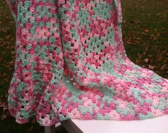 Crocheted pink and green granny square afghan