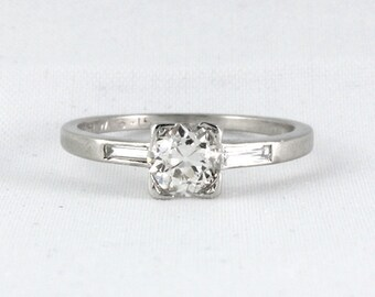 Vintage diamond platinum engagement ring. 0.76 carat old European. Circa 1930.