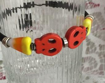 Flat Orange Stone Skulls with Glass Candy Corn Bead Halloween Stretch Bracelet