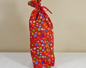 Bottle gift bag unlined in red balloon fabric