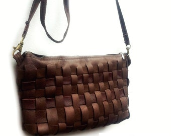 Unique little handbag handmade and braided with recycled leather.