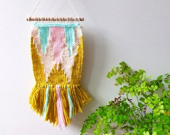 Woven wall hanging miniature in mint green, pale pink, mustard yellow and cream, with geometric pattern