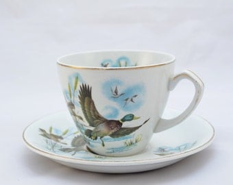 Alfred Meakin 'Flying Ducks' teacup and saucer, 1950s