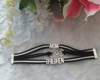 Woven friendship bracelet with charms
