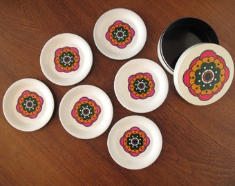 Set of 6 vintage 1960s or 1970s melamine coasters with retro flowers with tin, white with pink, orange and green flowers