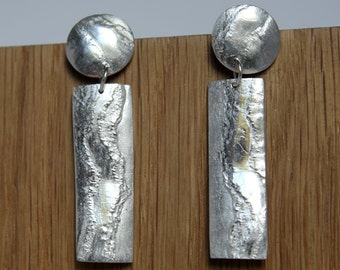 Fine silver drop earring with a washed shoreline texture