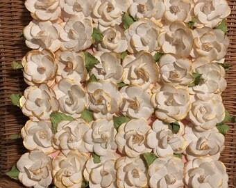 Gold dipped flower wall hanging.