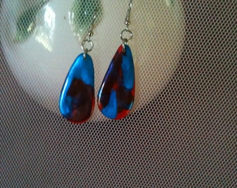 red and blue handshaped earrings