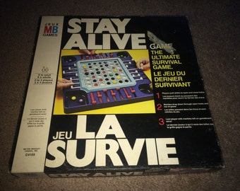 Vintage (c.1971) Stay Alive board game published by Milton Bradley 100% complete.  Great shape for its age.
