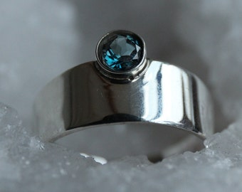 Plate ring London Blue Topaz, tight silver color ring