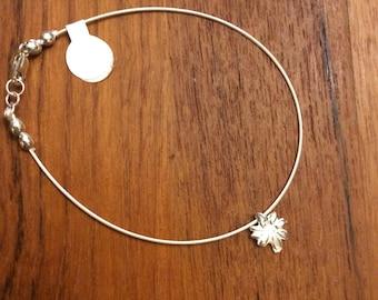 Tiny silver flower charmed bracelet