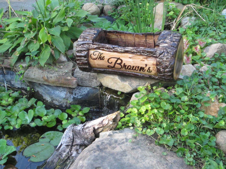 Garden pond decor coy pond decor wood burned by forestofnature for Pond decorations