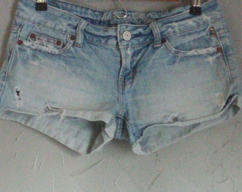American Eagle cut off studded shorts, pyramid studded back pocket shorts, denim cut offs, one of a kind shorts, hand cut denim