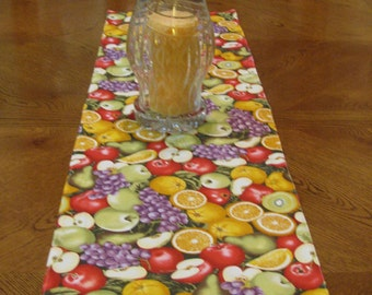 Colorful and lovely fruit table runner.  Take your pick of the freshest fruit around, apples, oranges, grapes, pears or kiwi.