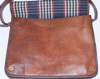 "Heathbold Strabo. Engraved monogram or personalised message options. Biker messenger style laptop bag. Brown leather. XL for 15.4"" Macbook"