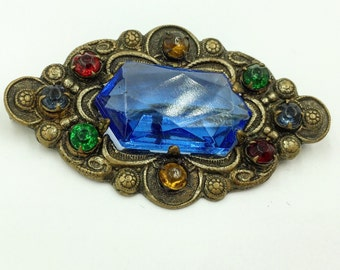 1930 's gorgeous brooch with large blue Czech glass stones and multi color glass stone around