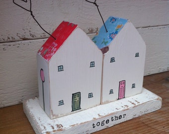 A pair of little wooden houses - white & bright