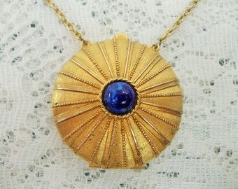 Vintage Solid Perfume Compact, Estee Lauder, golden starburst locket, blue cabochon, long chain necklace pendant