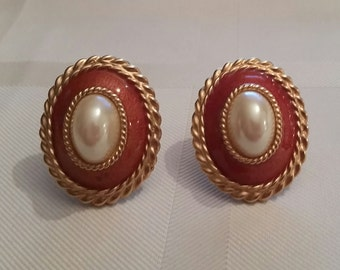 Coral color faux pearl clip on earrings.