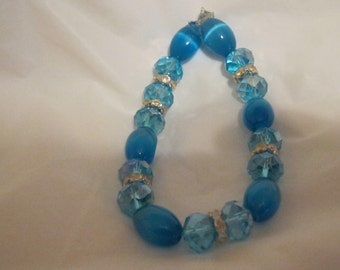 Bracelet blue glass oval beads multi color stretch