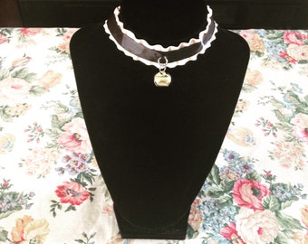 Black and pink choker with cat bell.