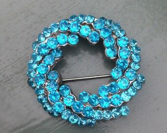Stunning vintage turquoise rhinestone circle brooch