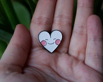 Pin: blushing heart.