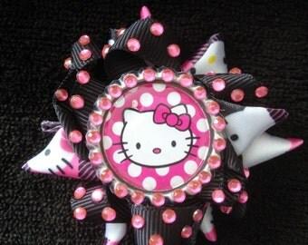 A delightful pink polka dot Hello Kitty small hair clip!