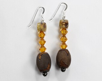 Silver filled, amber colored swarovski crystals, brown and beige beads