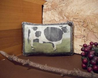 Pillow Tuck: Primitive Rustic Americana Cow Pillow Tuck.