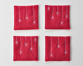 Red star coasters. Red linen, fabric coasters, machine-stitched quilted motif. Patterned back. Reversible. Housewarming gift. Christmas gift