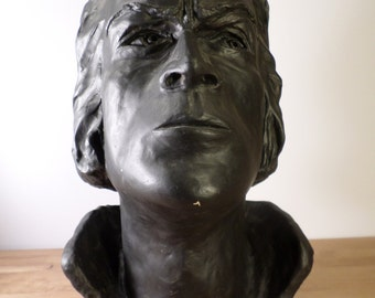 Large head in plaster painted