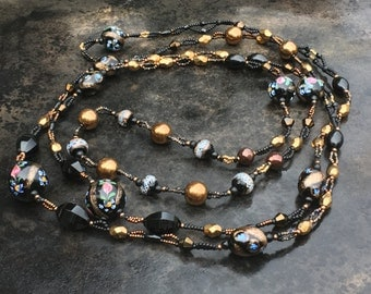 Extra long woven double strand necklace of antique fancy venetian glass beads, Whitby jet, bronze and jet glass.