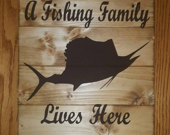 A Fishing Family Lives Here Wood Sign