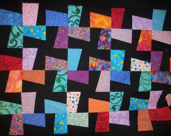 Windmill Quilt with Black Background